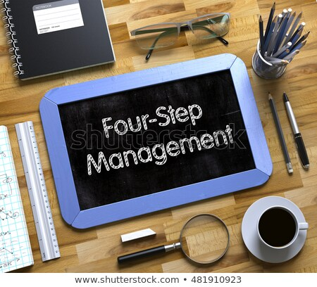 Four-Step Management - Text on Small Chalkboard. 3D Illustration. Stock photo © tashatuvango