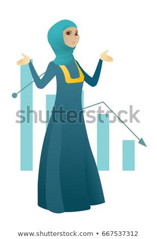 Bancrupt muslim business woman with spread arms. Stock photo © RAStudio