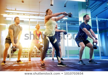 Fiatal nő izmok kettlebell tornaterem fitnessz sport Stock fotó © dolgachov
