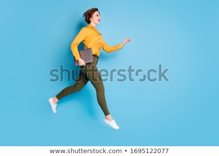 Woman runner jumping in air Stock photo © IS2