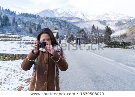 Female tourist taking picture of mountain landscape with compact Stock photo © stevanovicigor