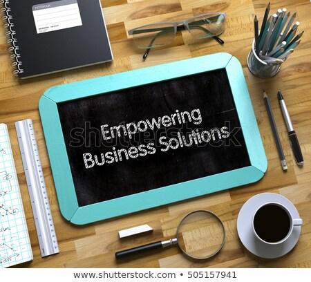 empowering business solutions on small chalkboard 3d stock photo © tashatuvango