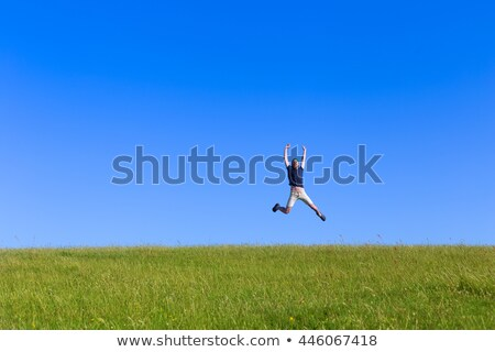 Man jumping into distance on grass Stock photo © IS2