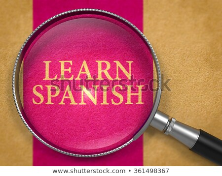 learn foreign languages through lens on old paper stock photo © tashatuvango
