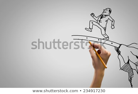 Funny businessman is stepping forward Stock photo © studiostoks