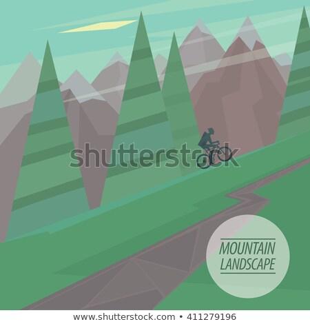 Flat mountain landscape with steep slopes, trees and cyclist riding Stock photo © alexanderandariadna