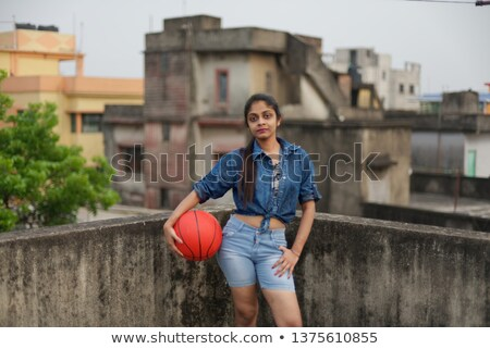 Basketball player with ball on rooftop Stock photo © IS2