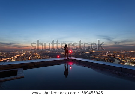 Man standing on urban rooftop Stock photo © IS2