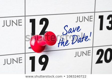 Wall calendar with a red pin - June 12 Stock photo © Zerbor