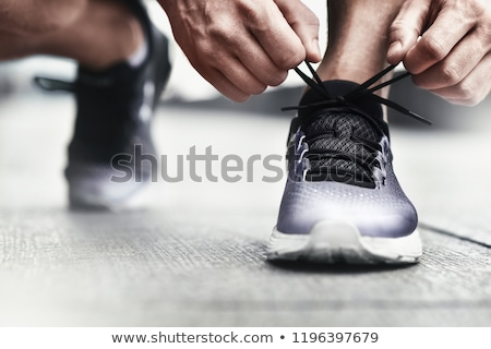 Close up of a man tying tying shoelaces Stock photo © deandrobot
