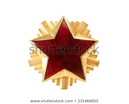 Old red star from military cap isolated on the white background Stock photo © boggy