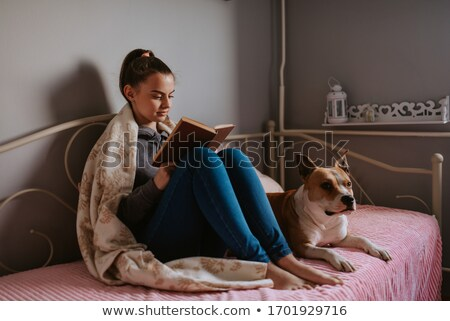 happy female friends reading book at home Stock photo © dolgachov