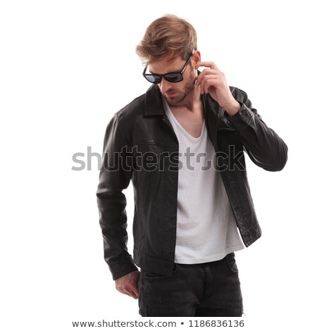 Homem jaqueta de couro pensando olhando para baixo lado retrato Foto stock © feedough