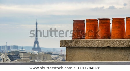 The roofs of Paris and its chimneys under a clouds sky Stock photo © FreeProd
