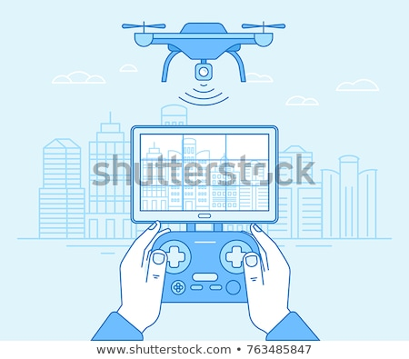 hands holding controller flying drone quadcopter stock photo © jossdiim