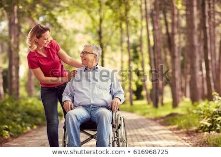 nő · öreg · szék · fiatal · nő · ül · fehér - stock fotó © andreypopov