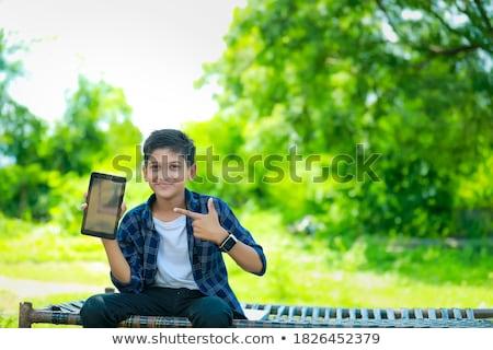 Portrait of Smiling Teenage Boy Holding Mobile Phone Stock photo © monkey_business
