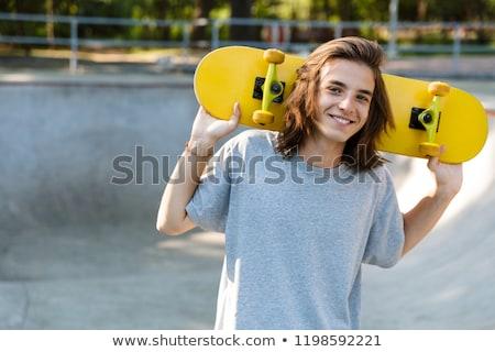 Mutlu genç erkek zaman paten park Stok fotoğraf © deandrobot