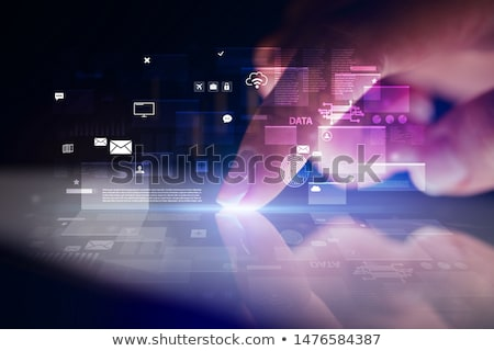 finger touching tablet with global database concept stock photo © ra2studio