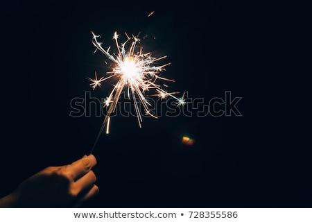 Mannelijke hand sterretje nieuwjaar partij Stockfoto © unkreatives