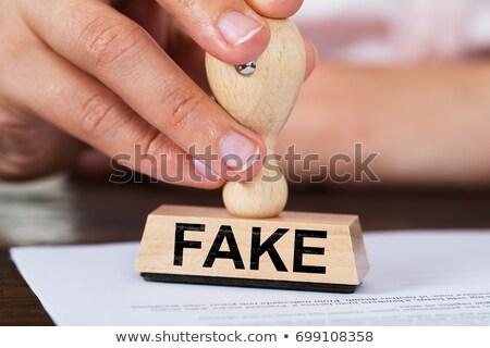 Pessoa falsificação carimbo papel Foto stock © AndreyPopov