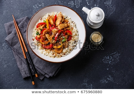 Stock photo: Chicken stir fry with vegetables and rice