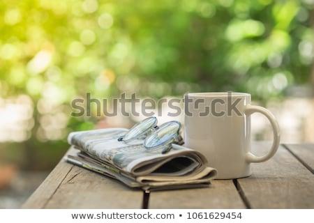 reading news in cafe stock photo © pressmaster