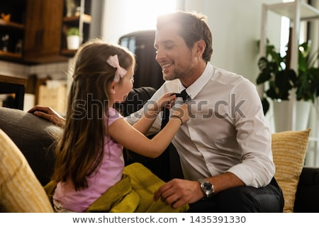 daughter assisting father with work stock photo © pressmaster