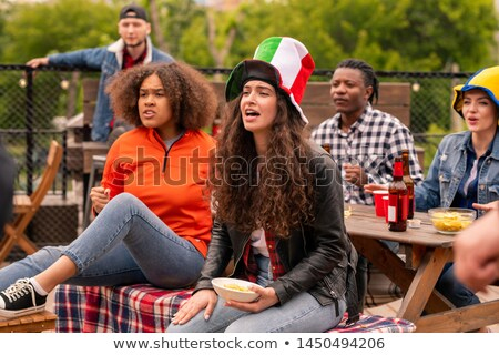 Group of young friendly football fans being nervous while watching broadcast Stock photo © pressmaster