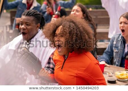 счастливым · девушки · смотрят · хоккей · матча · вещать - Сток-фото © pressmaster