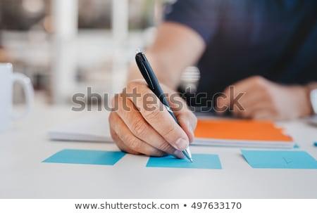 Jovem empresário escrita notas vista lateral anexada Foto stock © AndreyPopov