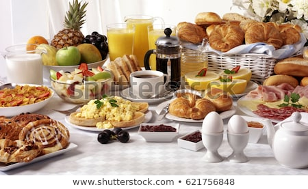 Toasts with cold cuts for breakfast with orange juice on white Stock photo © dla4