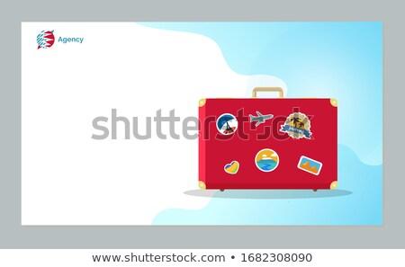 Czasu podróży czerwony bagaż naklejki stronie Zdjęcia stock © robuart