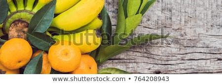 Colorful fruits on the white wooden table, Bananas, carambola, mango, papaya, mandarin, rambutan, pa Stock photo © galitskaya