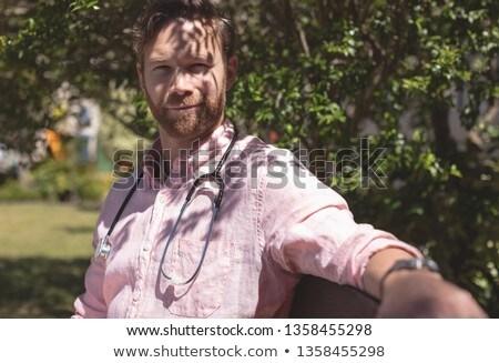 Portre kafkas erkek doktor oturma bank dışında Stok fotoğraf © wavebreak_media