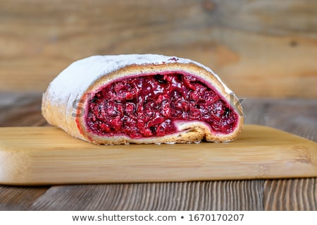 Cherry strudel on wooden background Stock photo © Alex9500