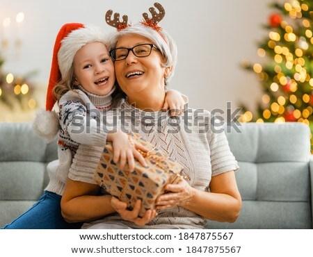 Avó neta little girl assistindo usando laptop computador Foto stock © rcarner