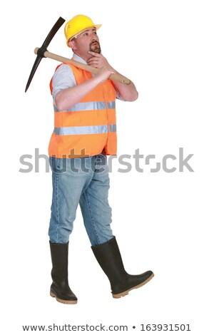 Contemplative labourer holding a pickaxe Stock photo © photography33
