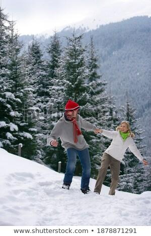 Férfi nő mosolyog domboldal nő szeretet hideg Stock fotó © IS2