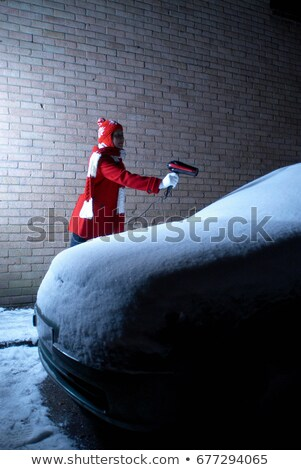 Girl defrosting car with hair drier Stock photo © IS2