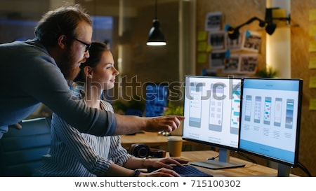 creative team drinking coffee at night office stock photo © dolgachov