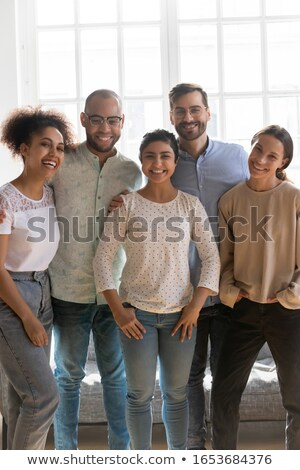Group of positive optimistic young multi-ethnic colleagues Stock photo © pressmaster