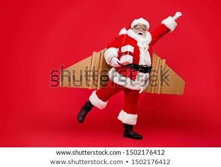 Merry Christmas Greeting With Santa Claus In Flight With His Reindeer And Sleigh.  Stock photo © hittoon