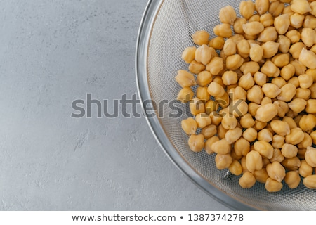 Close up shot of raw chickpeas in sieve. Healthy food. Roasted garbanzo. Eco vegetarian dish concept Stock photo © vkstudio