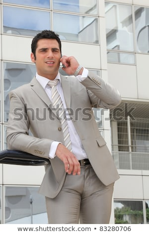 businessman stood outside office telephoning stock photo © photography33