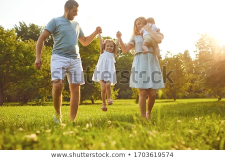 family with baby stand on grass Stock photo © Paha_L