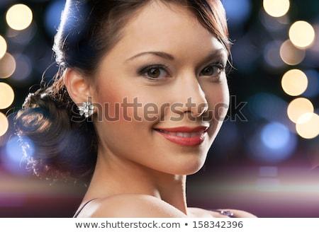 Beautiful Woman in Black Evening Dress Wearing Jewelry  Stock photo © NicoletaIonescu