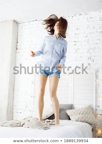 小さな · かなり · ブルネット · 女性 · ベッド · 座って - ストックフォト © iordani