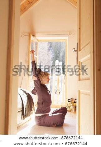 woman sitting on bedroom floor in chalet Stock photo © IS2
