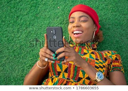 Woman lying using phone Stock photo © IS2